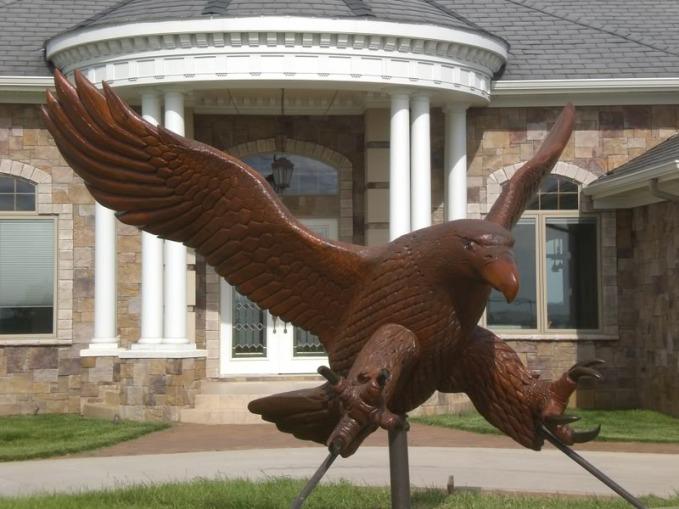 Eagle Monument Sculture Commissioned by John Chudy for Copper Ridge housing development. 7'X11' 2008. Cedar Wood